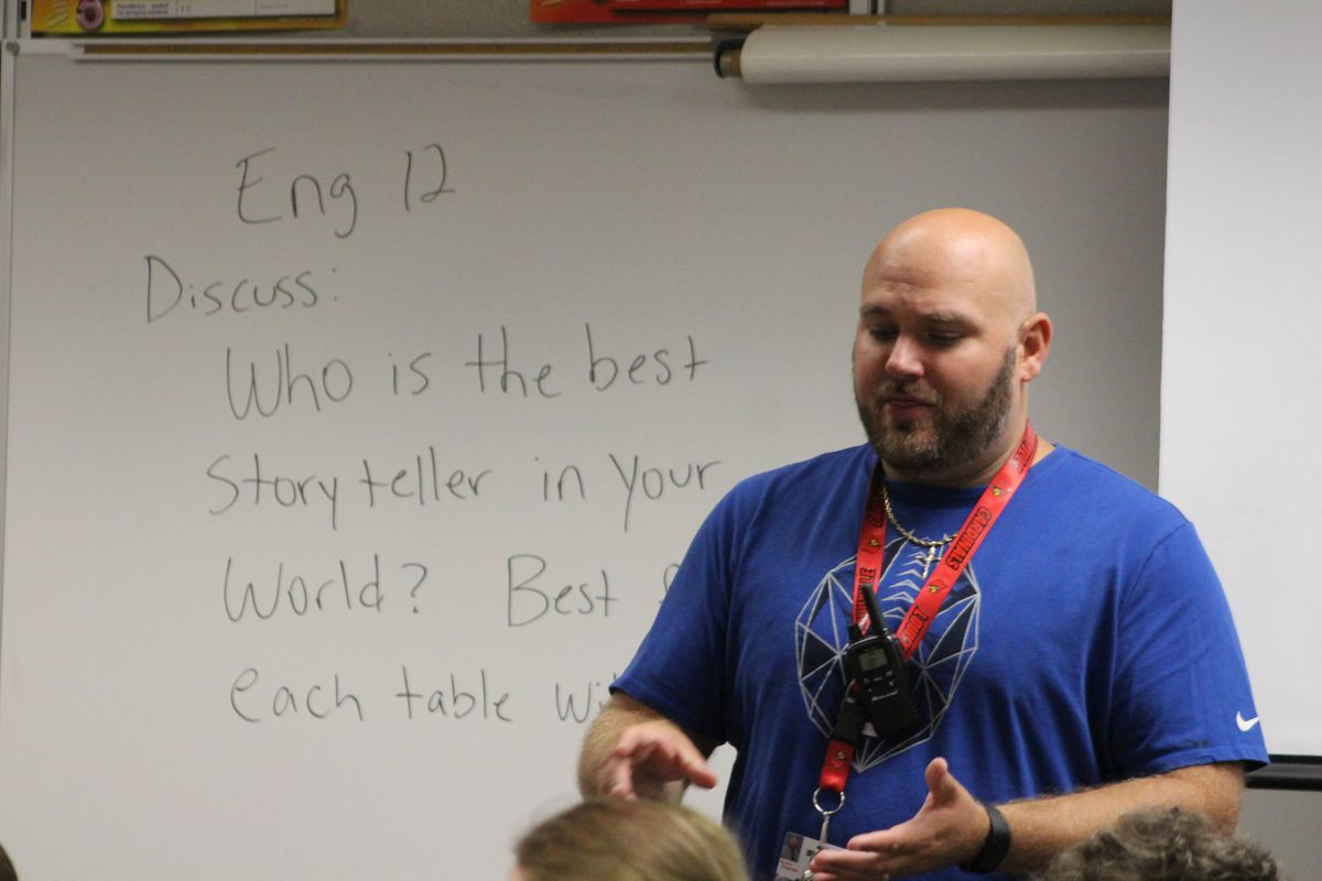 Austin High School teacher Brandon Stagnolia welcomes his English 12 students to their fourth day of school.