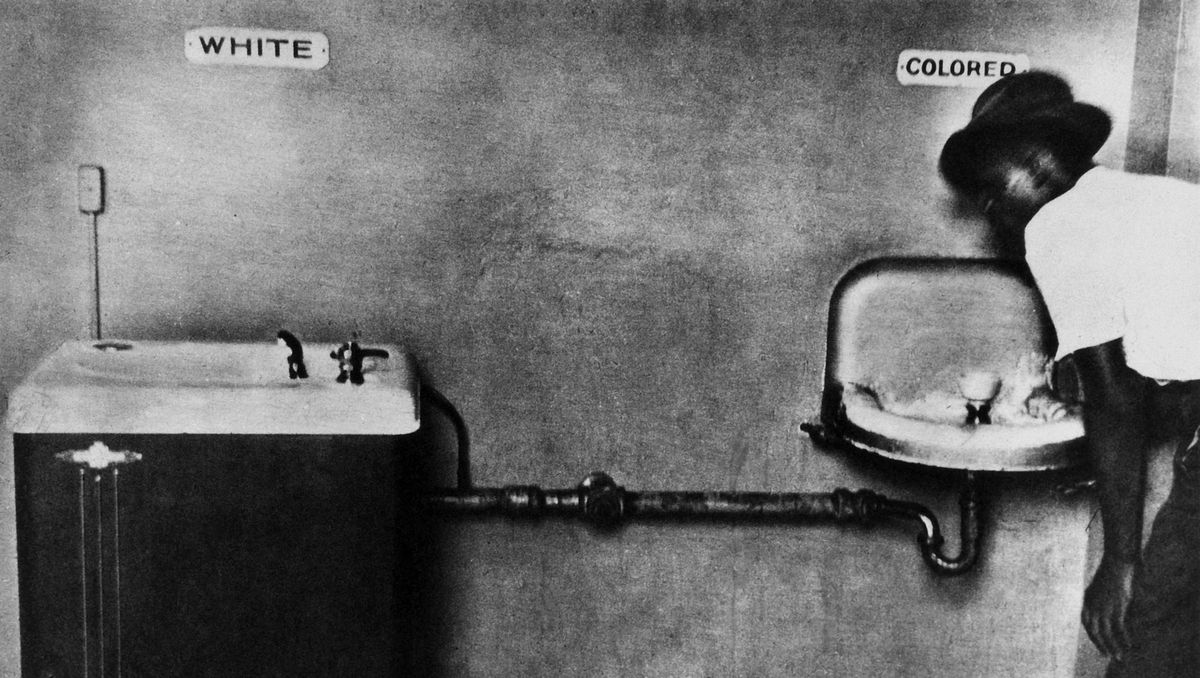 """A segregated """"day hotel"""" in Alabama in 1950 included different water fountains for white and black patrons."""