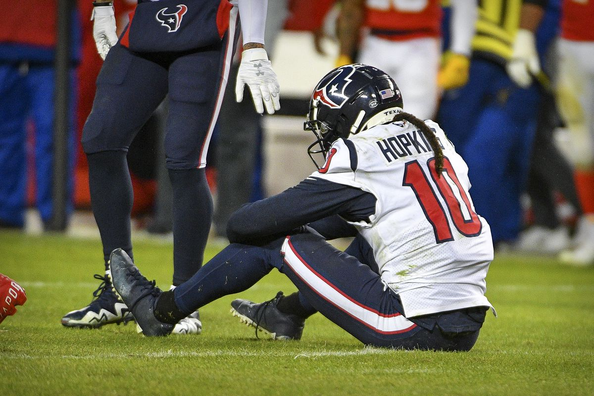 Houston Texans wide receiver DeAndre Hopkins reacts to being tackled by the Kansas City Chiefs defense during the fourth quarter in a AFC Divisional Round playoff football game at Arrowhead Stadium.