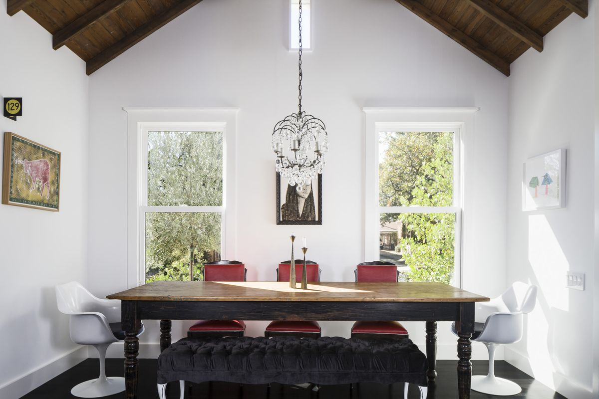 The dining room with a wooden vaulted ceiling.