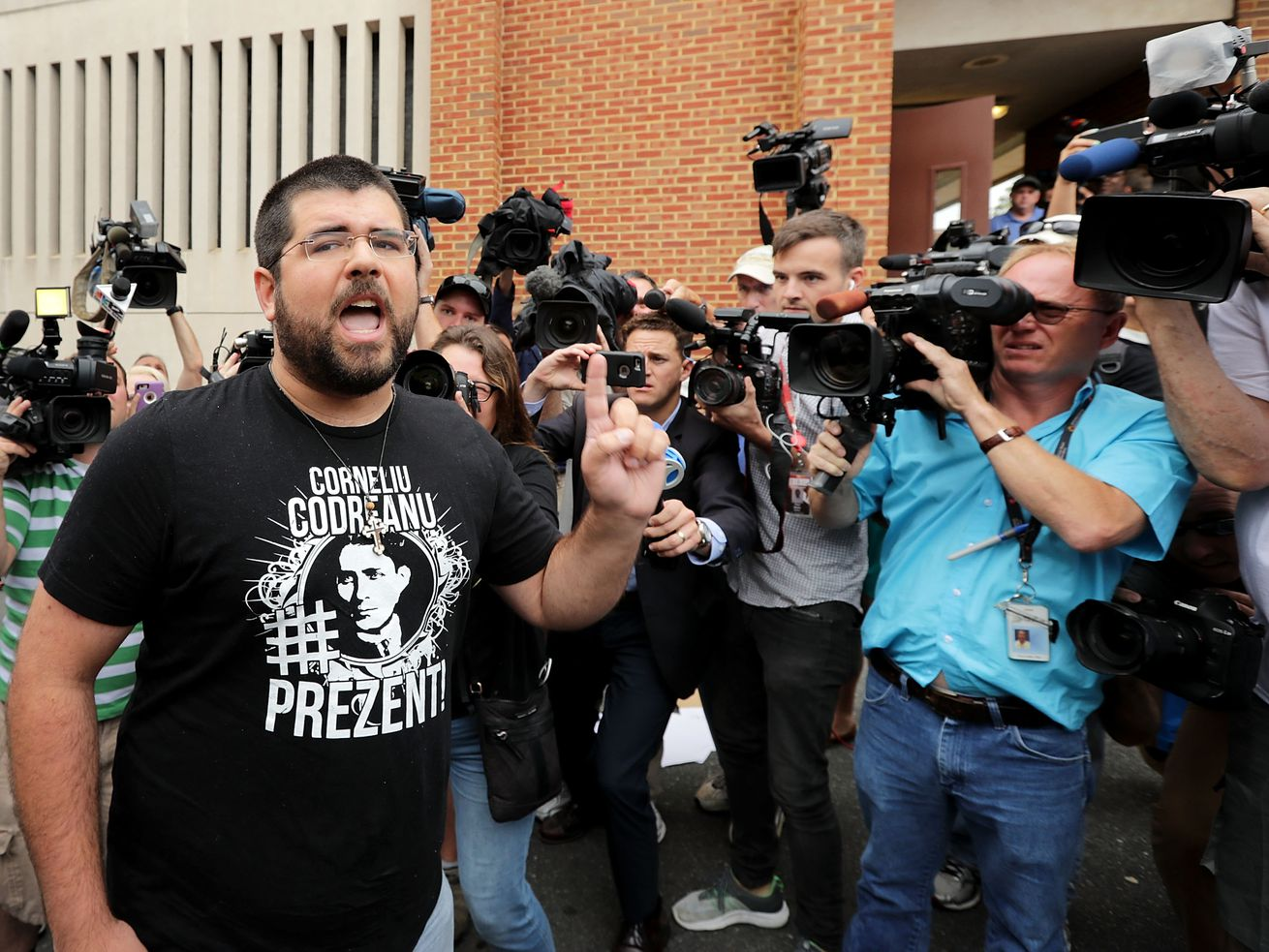 After the 2017 Virginia Unite the Right march, a man shouts at reporters gathered outside the Charlottesville General District Court.