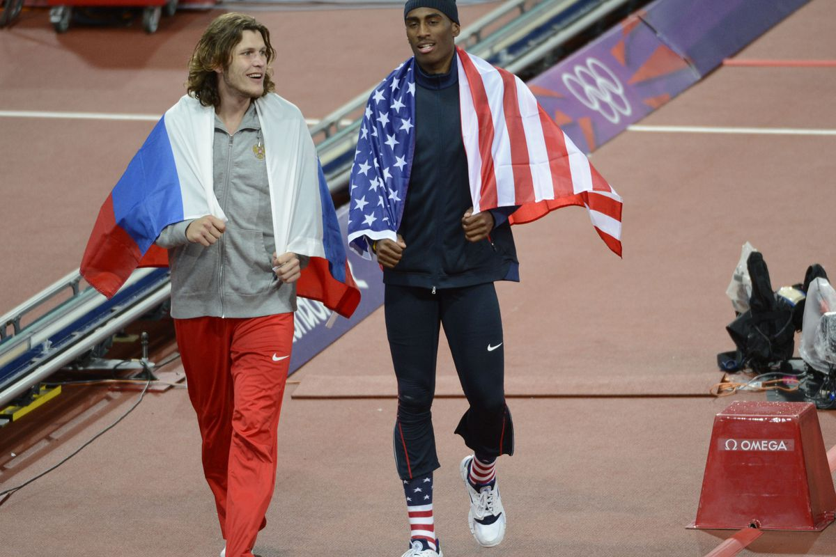 One of these guys still has collegiate eligibility, and competes for K-State.  This picture must mean <em>something</em>.  But what, I wonder?  (John David Mercer-USA TODAY Sports)
