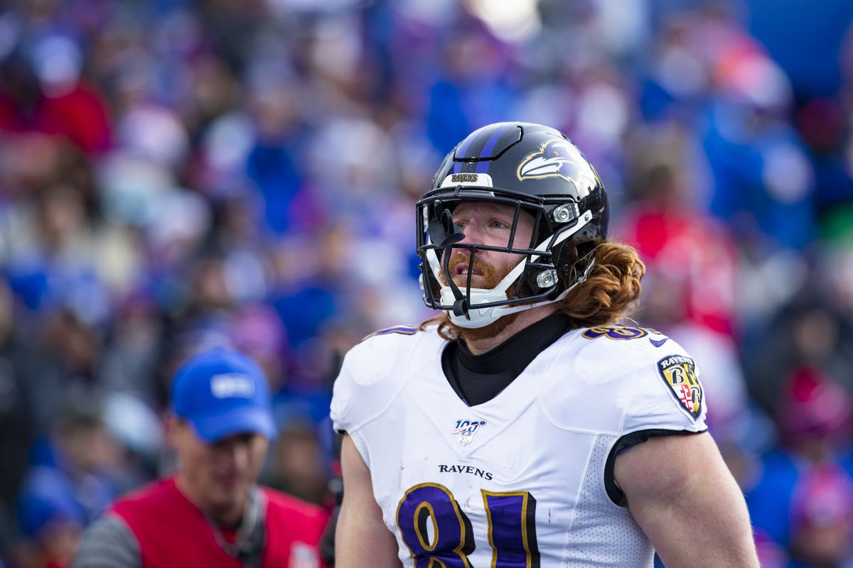 Hayden Hurst #81 of the Baltimore Ravens celebrates a touchdown against the Buffalo Bills during the third quarter at New Era Field on December 8, 2019 in Orchard Park, New York. Baltimore defeats Buffalo 24-17.