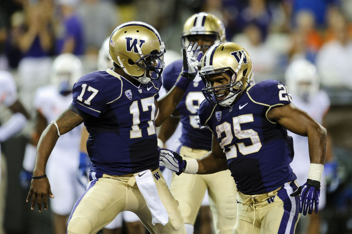 Husky captains Bishop Sankey and Keith Price had a lot to celebrate during the opening of the new Husky Stadium last Saturday night.