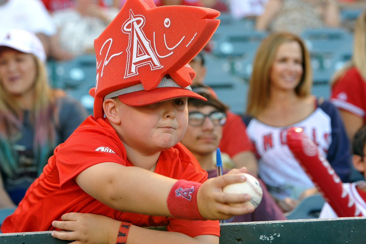July 20, 2012; Anaheim, CA, USA;  Colby Bennett, 7 years old from Bakersfield, CA tires for an autograph before the game between the Los Angeles Angels and the Texas Rangers at Angel Stadium. Mandatory Credit: Jayne Kamin-Oncea-US PRESSWIRE
