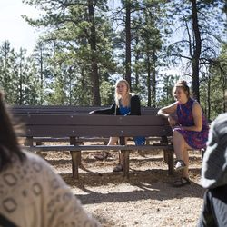 Gabi Sheeley, left, Eric Meeks, Meleeza Hall and Amy Auble sit and talk while waiting for the 9:30 a.m. nondenominational Christian church service in Bryce Canyon National Park, Sunday, June 18, 2017.