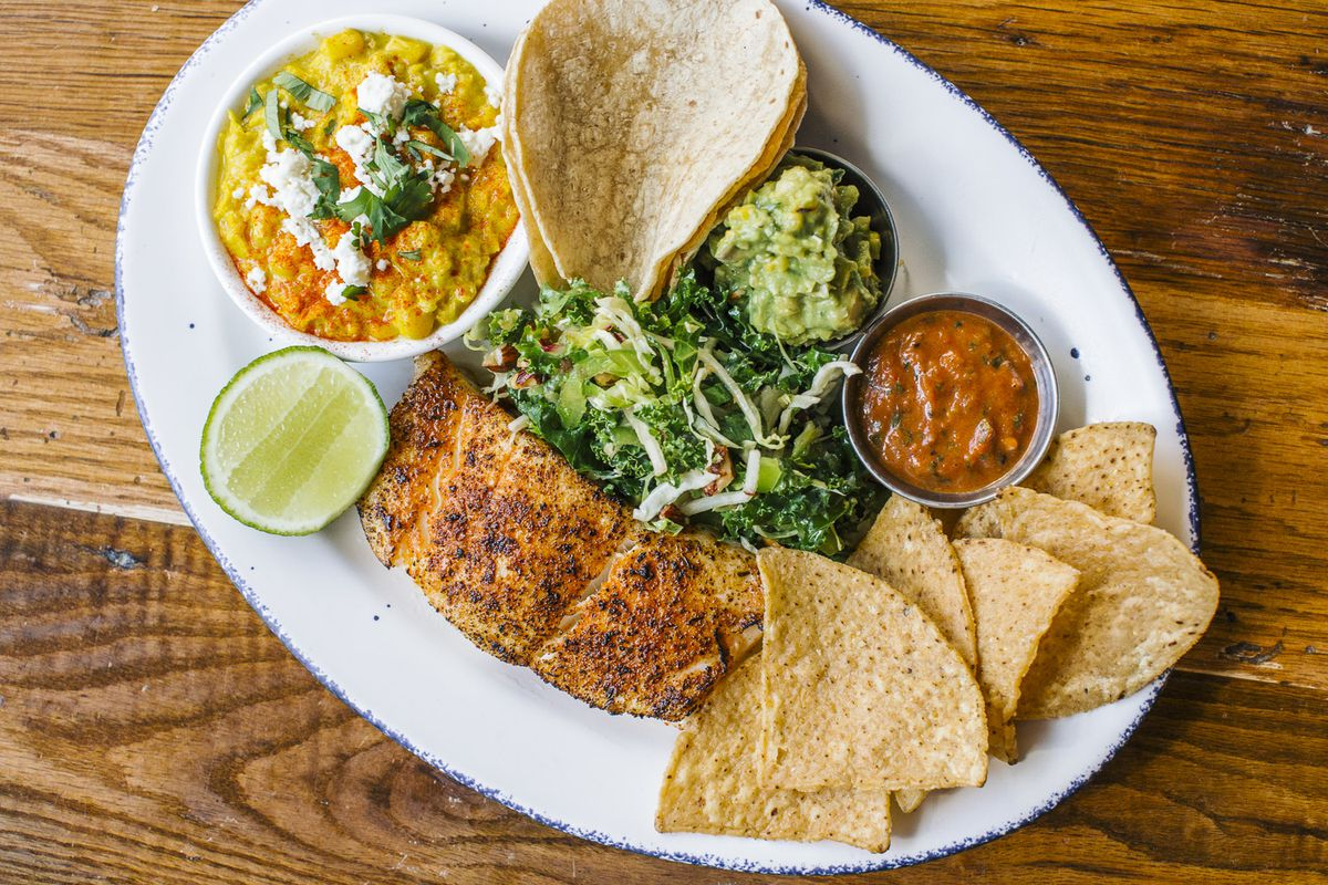a plate of blackened halibut and taco fixings