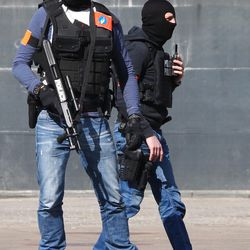 Belgian police officers patrol outside the Gare du Midi train station in Brussels, Tuesday, March 22, 2016. Explosions, at least one likely caused by a suicide bomber, rocked the Brussels airport and its subway system Tuesday, prompting a lockdown of the Belgian capital and heightened security across Europe.