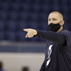 BYU basketball coach Mark Pope points during practice at the Marriott Center in Provo, Utah.