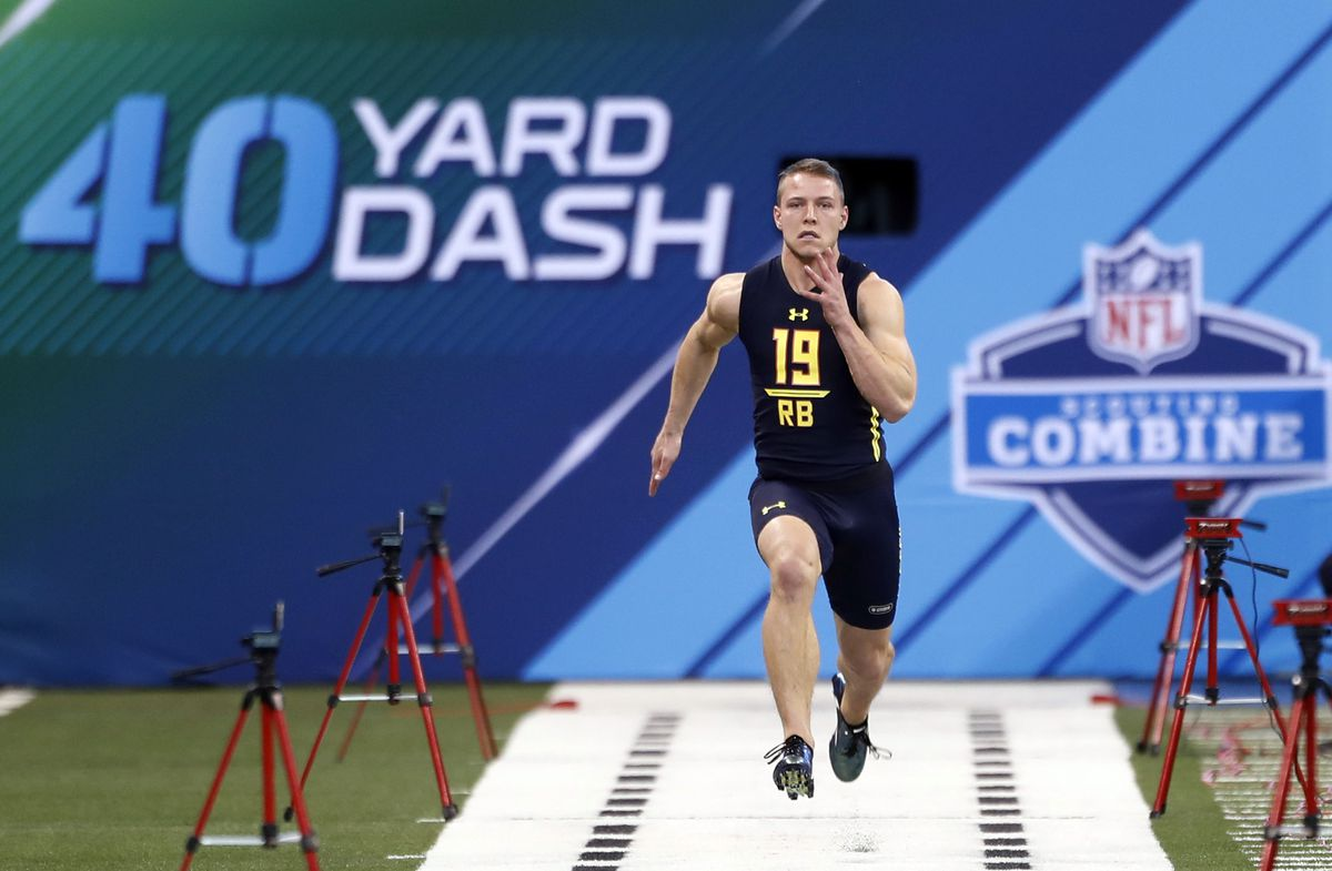 INDIANAPOLIS, IN - Former Stanford Cardinal running back Christian McCaffrey runs the 40-yard dash during the 2017 NFL Scouting Combine at Lucas Oil Stadium.