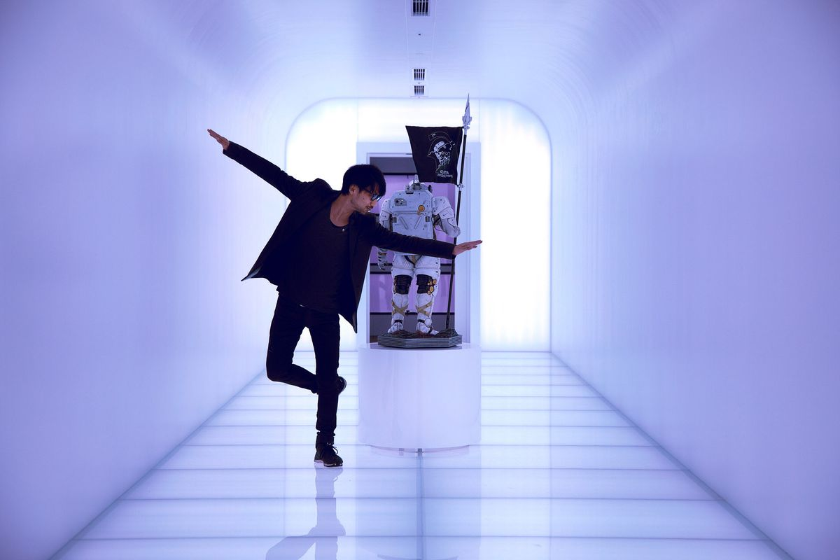 Kojima poses in a purple hallway.