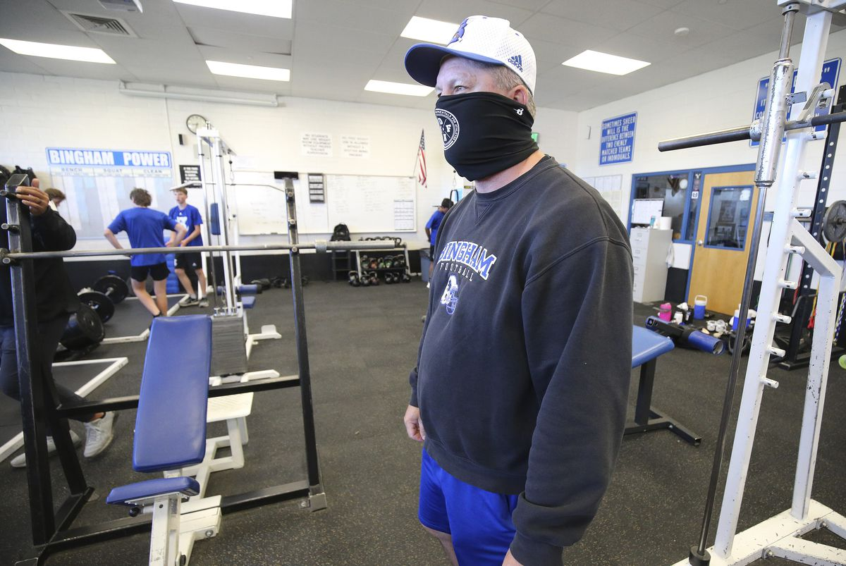 Bingham High School football coach Dave Peck watches players during a workout in South Jordan on Wednesday, June 10, 2020.