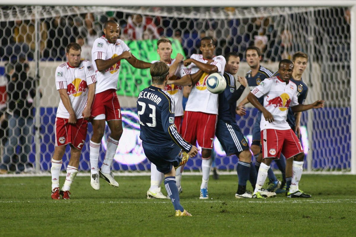HARRISON, NJ - OCTOBER 04: David Beckham #23 of the Los Angeles Galaxy attempts a free kick against the New York Red Bulls during the game at Red Bull Arena on October 4, 2011 in Harrison, New Jersey. (Photo by Andy Marlin/Getty Images)