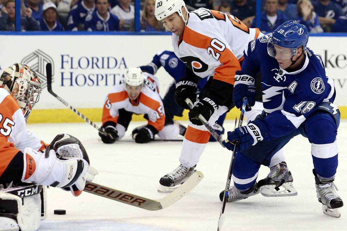 Tampa Bay's Ondrej Palat challenges Flyers goalie Steve Mason in Tampa Bay's 3-2 opening night win Thursday night.