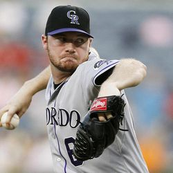 Colorado Rockies starting pitcher Alex White (6) works in the first inning of a baseball game against the Atlanta Braves, Wednesday, Sept. 5, 2012, in Atlanta.