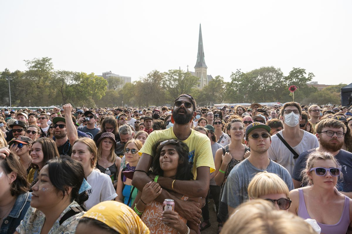 Festival-goers slowly sway and sing along as Waxahatchee performs on the Green Stage at Pitchfork music festival at Union Park, Saturday, Sept. 11, 2021.