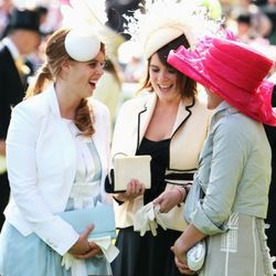 ASCOT, UNITED KINGDOM - JUNE 19:  HRH Princess Eugenie, Princess Beatrice and Autumn Philips share a joke in the parade ring during Ladies Day at Royal Ascot on June 19, 2008 in Ascot, England.