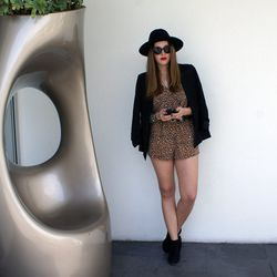 """SF blogger Bryn Newman of <a href=""""http://www.stonefoxstyle.com/""""target=""""_blank"""">Stone Fox Style</a> wearing a romper from a San Francisco boutique, a handmade belt from a friend, Target heels, a Truth & Pride blazer, an H&M hat and Rayen Optics sunglasse"""