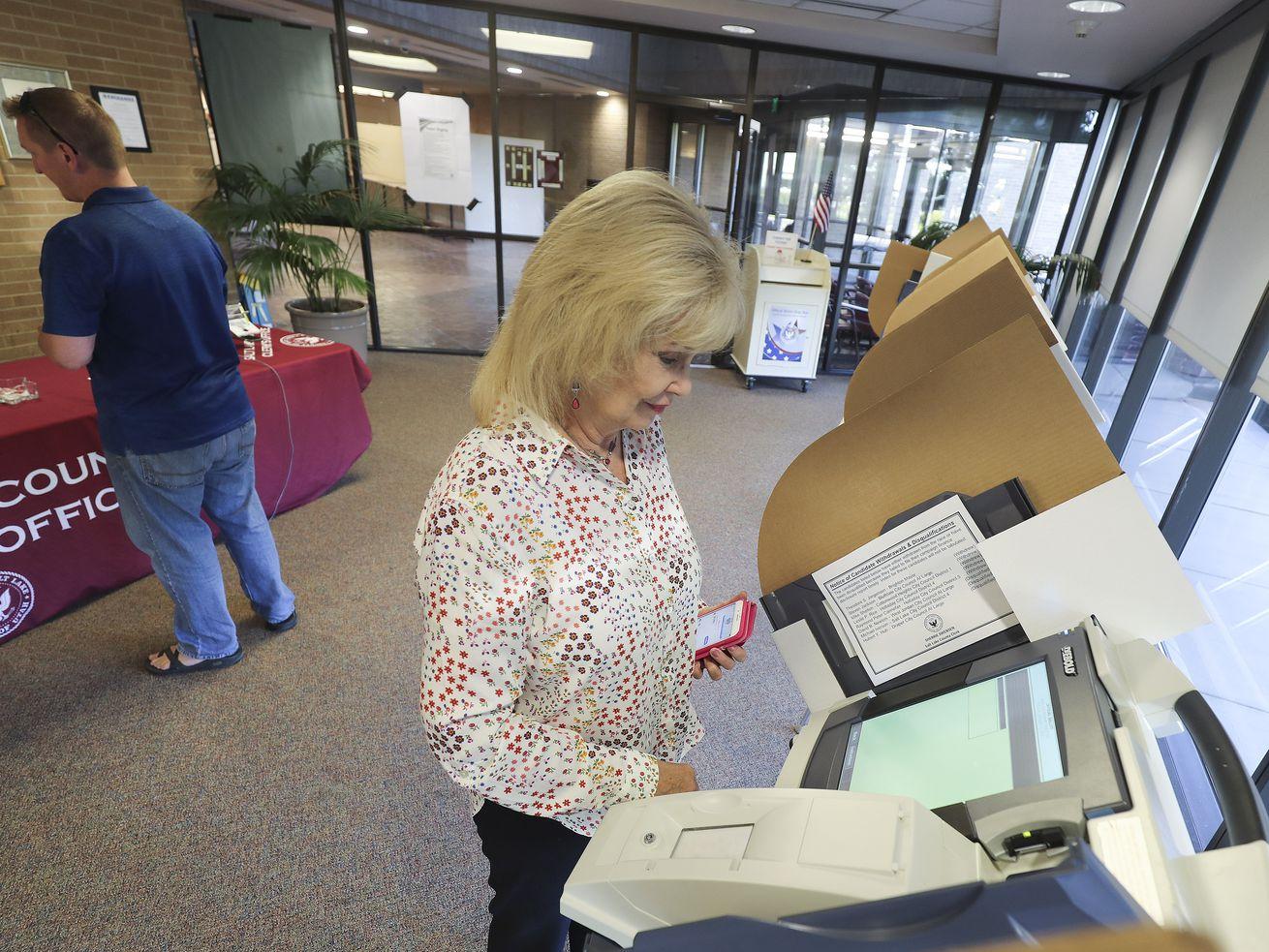 Sherrie Swensen, Salt Lake County Clerk, votes at the Salt Lake County Government Center in Salt Lake City on Tuesday, Aug. 13, 2019.