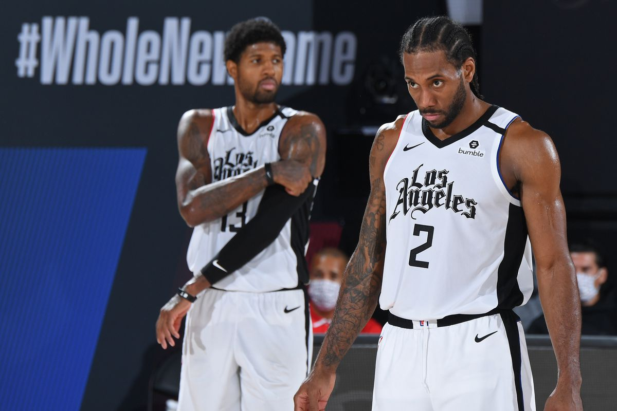 Kawhi Leonard of the LA Clippers and Paul George of the LA Clippers seen on court during Game Six of the Western Conference Semifinals on September 13, 2020 in Orlando, Florida at AdventHealth Arena.
