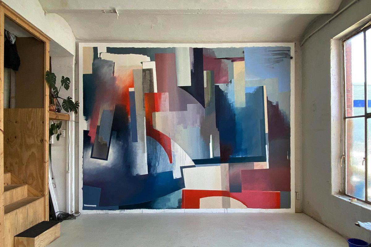 A wall painted with big strokes of blue, red, and white.