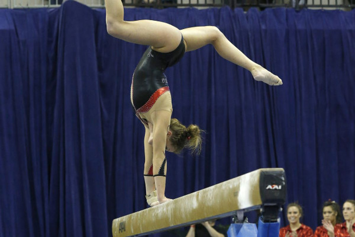Brittany Rogers with her trademark (whatever you call that) move on the balance beam.