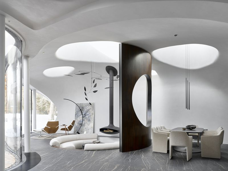 Living room with round skylights and round conversation pit.
