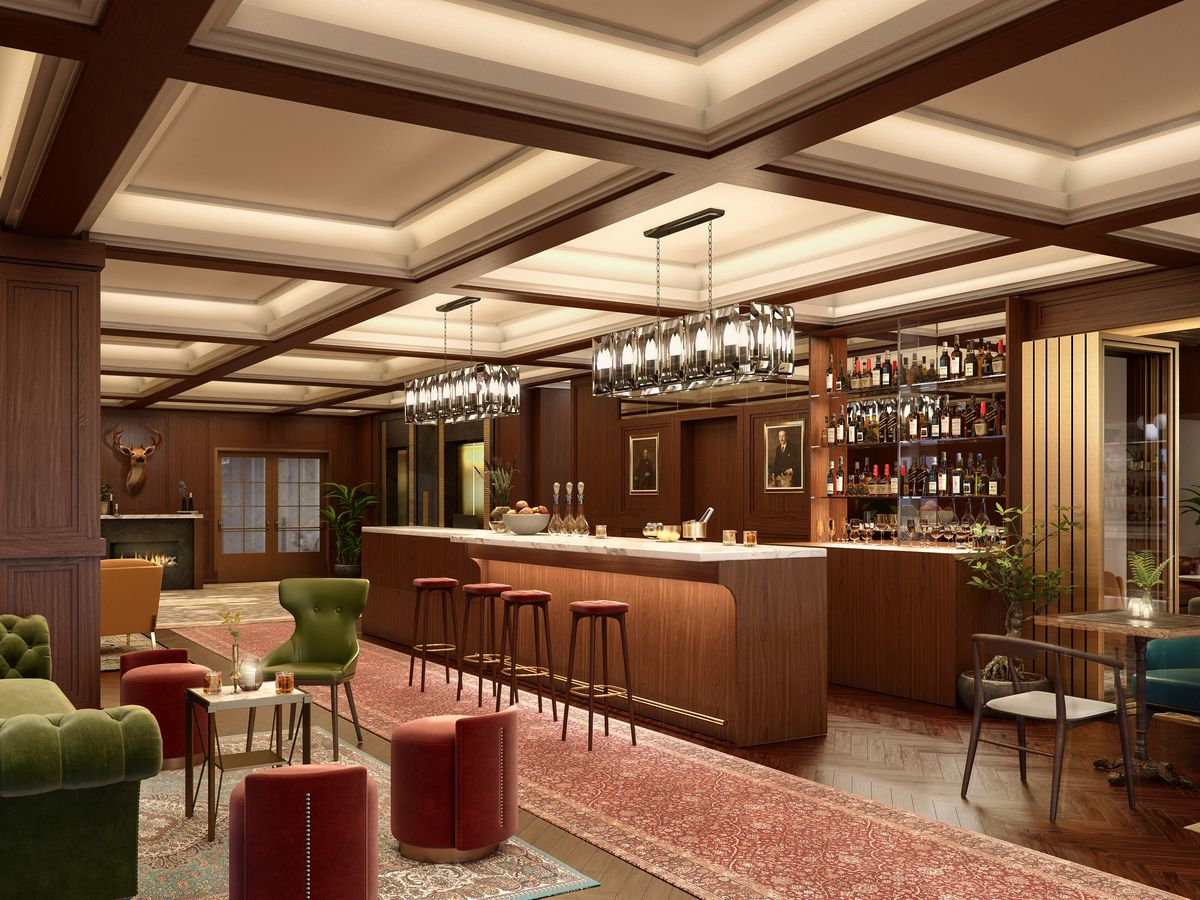 A hotel bar. There is a bar with stools that has shelves with liquor. There are tables, couches, and chairs.