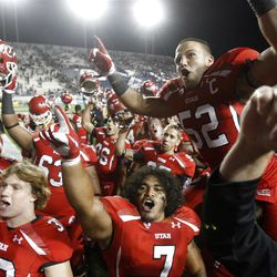 Utah players celebrate their 54-10 win over BYU Saturday, Sept. 17, 2011
