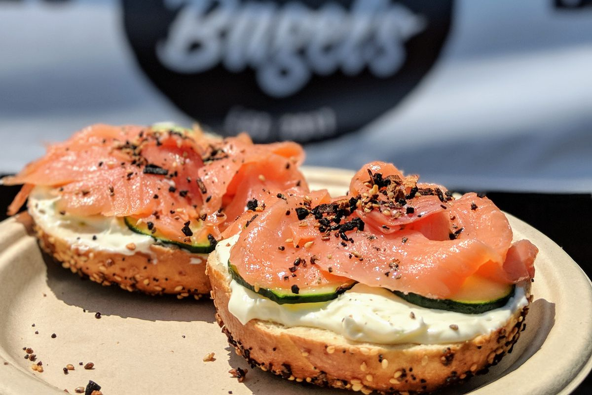 Pop's Bagels at Smorgasburg on a white plate in the sunshine.