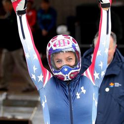 Noelle Pikus-Pace celebrates after crossing the finish line during the United States women's skeleton team trials Monday, Oct. 28, 2013, in Park City, Utah. Noelle Pikus-Pace came in first place after 2 heats.