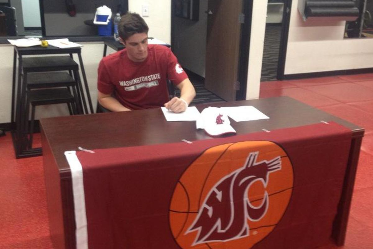 Tanner Lancona signs his National Letter of Intent.