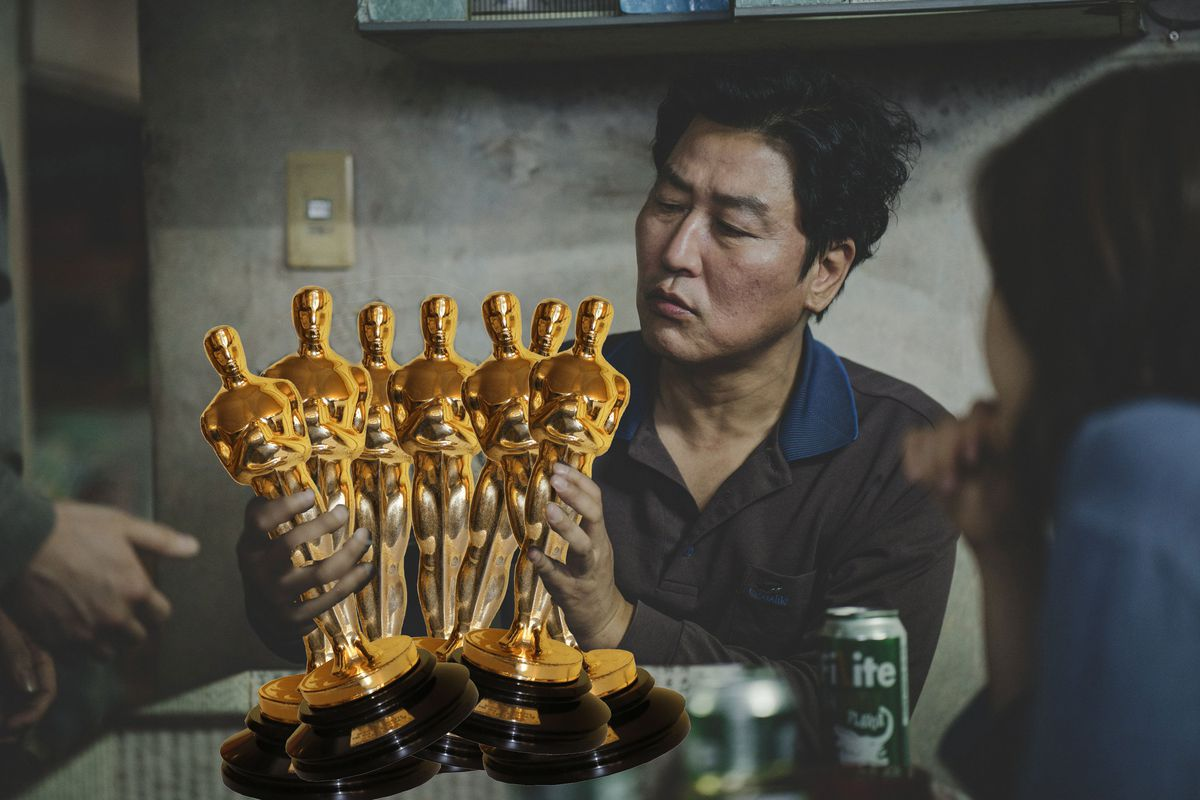 the guy from parasite holds a bunch of oscar statues