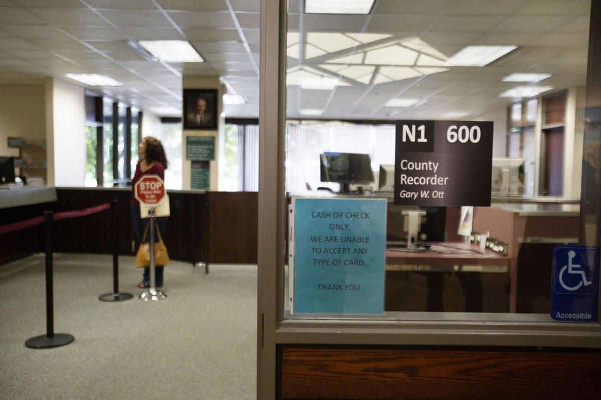 Citizens wait inside the general public area of the Salt Lake County Recorder\'s Office in Salt Lake City on Monday, June 5, 2017.