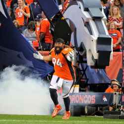 Broncos NT Domata Peko is fired up as he enters the playing surface.