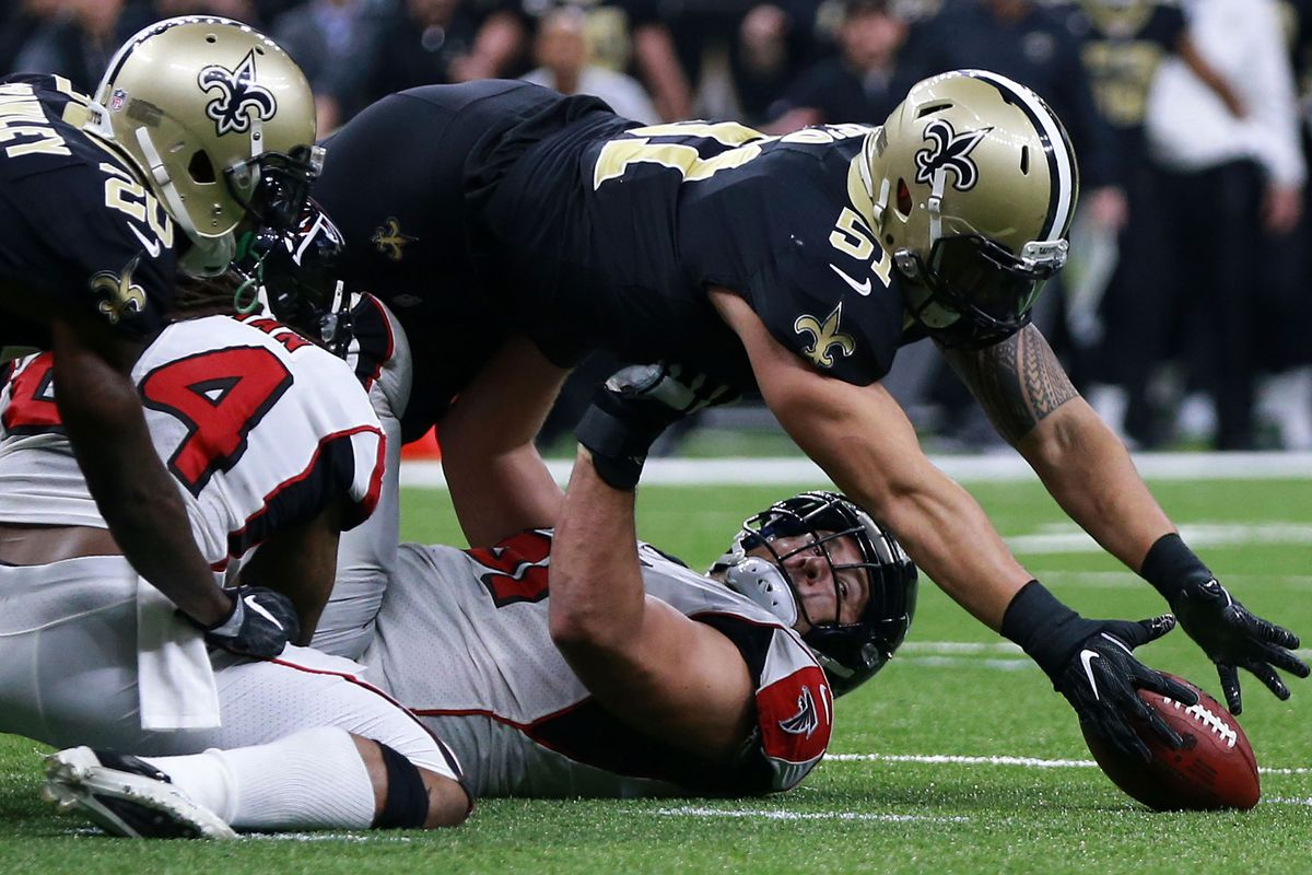 NEW ORLEANS, LA - DECEMBER 24:  Manti Te'o #51 of the New Orleans Saints  recovers a fumble during the second half of a game against the Atlanta  Falcons at the Mercedes-Benz Superdome.