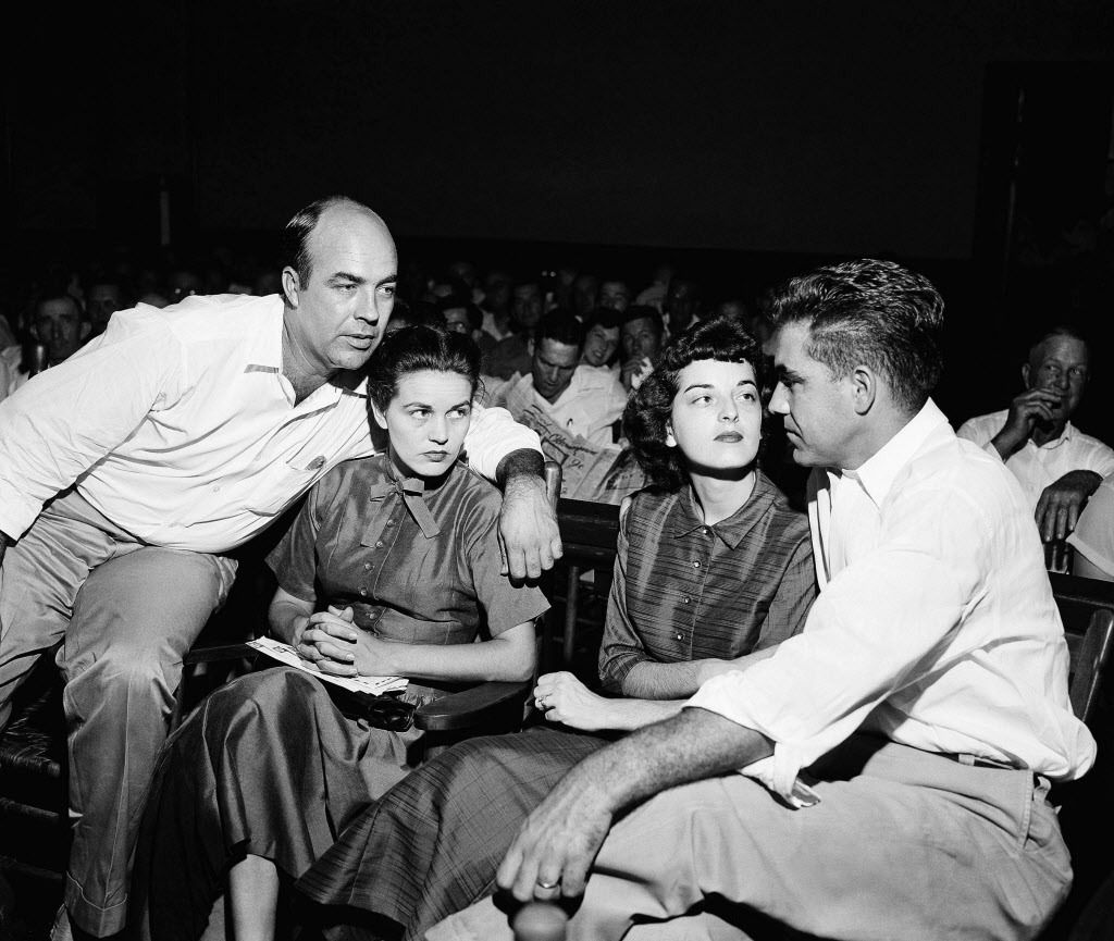 In this Sept. 23, 1955, file photo J.W. Milan (left), and Roy Bryant (right), sit with their wives in a courtroom in Sumner, Mississippi. Milam and Bryant were acquitted of murder in the slaying of Emmett Till.   AP file photo