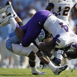 North Carolina's Tre Boston (10) tackles East Carolina's Justin Jones (84) during the first half of an NCAA college football game in Chapel Hill, N.C., Saturday, Sept. 22, 2012.