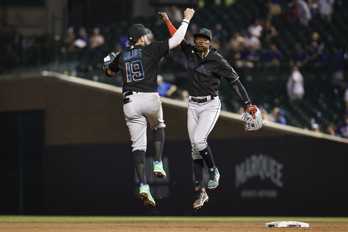 Miami Marlins shortstop Miguel Rojas (19) celebrates with second baseman Jazz Chisholm Jr. (2) team's win against the Chicago Cubs at Wrigley Field
