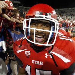 Utah Utes running back John White IV (15) celebrates the Ute's 54-10 win over BYU Saturday, Sept. 17, 2011