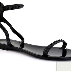"<a href=""https://www.stanleykorshak.com/products/Black-Rockstud-PVC-Sandal/8016"">Valentino Rockstud PVC sandal</a>, $206.50"