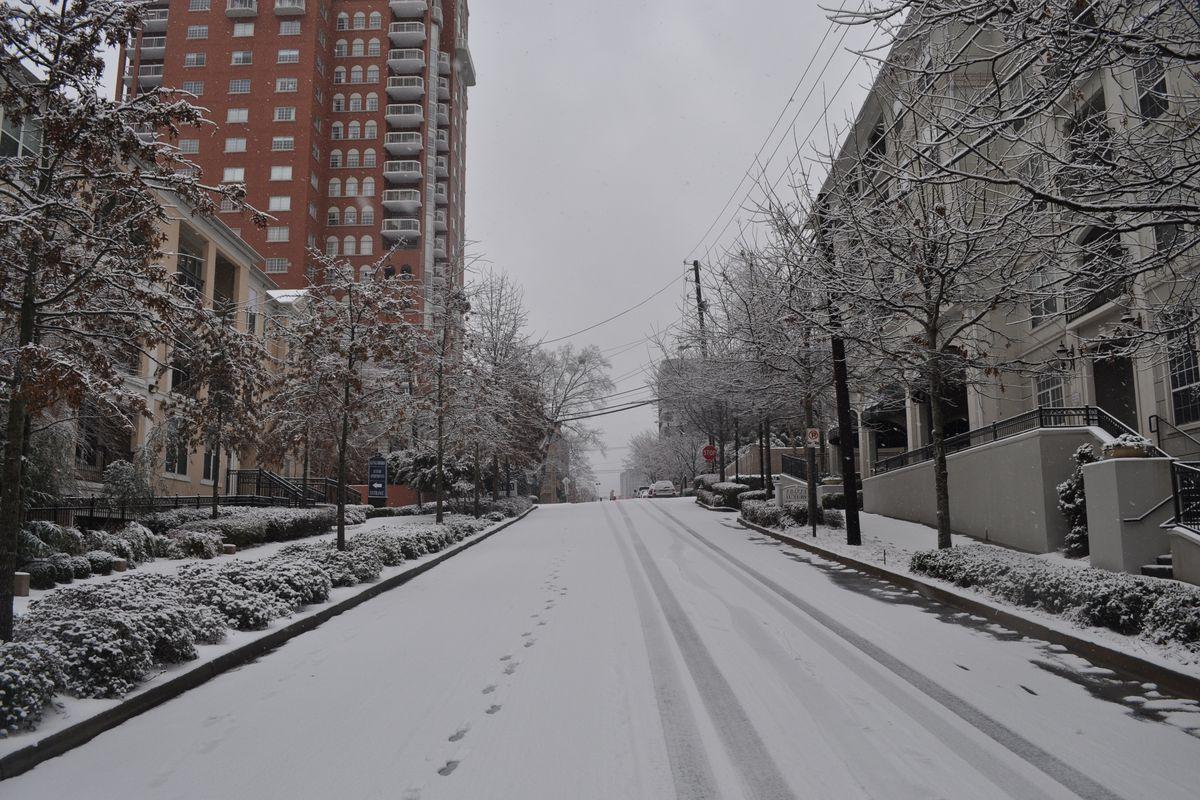 A serene street scene in Buckhead during snowfall in 2014.