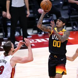 Utah Jazz guard Jordan Clarkson (00) pushes up a shot over Miami Heat forward Kelly Olynyk (9) as the Utah Jazz and the Miami Heat play an NBA basketball game at Vivint Smart Home Arena in Salt Lake City on Saturday, Feb. 13, 2021.