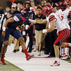 Utah Utes defensive back Chase Hansen pulls Arizona Wildcats quarterback Brandon Dawkins out of bounds in Tucson, Arizona, on Friday, Sept. 22, 2017. Utah beat Arizona 30-24.