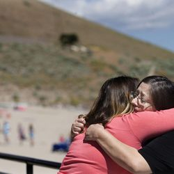 Lucinda Campbell, right, gets a hug from her sister, Amber Bishop, after Campbell spoke to reporters during a Utah Department of Transportation and Sleep Smart Drive Smart media briefing at Blackridge Reservoir in Herriman on Wednesday, June 14, 2017. Campbell's son, Tyler Blias, and his friend both died almost seven years ago after Blias' friend fell asleep while driving home from a summer trip to the Grand Canyon.