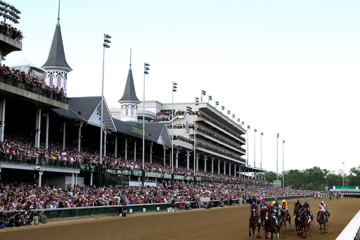 LOUISVILLE, KY - MAY 06:  Summer Soiree leads the field down the front stretch at the start of the 137th Kentucky Oaks at Churchill Downs on May 6, 2011 in Louisville, Kentucky.  (Photo by Rob Carr/Getty Images)