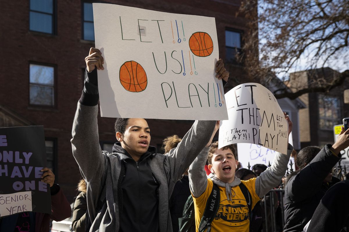 Students staged a protest Monday asking that the boys basketball team be allowed to play.
