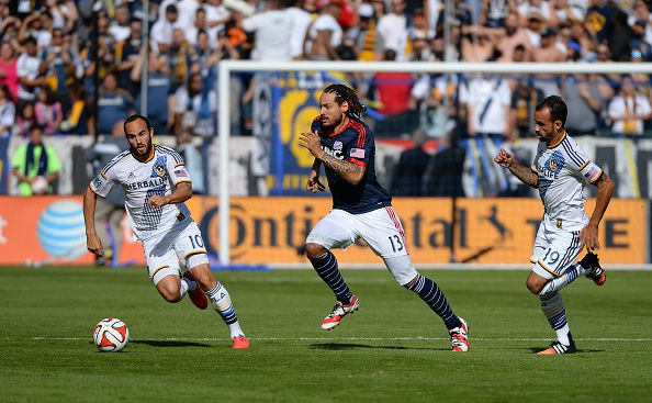 LOS ANGELES, CA - DECEMBER 07: Landon Donovan of the Los Angeles Galaxy plays against Jermaine Jones of the New England Revolution as Juninho of the Galaxy looks on during the 2014 MLS Cup match at the at StubHub Center on December 7, 2014 in Los Angeles, California. (Photo by Robert Laberge/Getty Images)