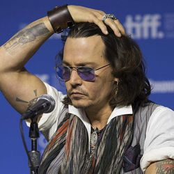 """Actor Johnny Depp gestures a press conference to show his support for the documentary """"West of Memphis"""" at the 2012 Toronto International Film Festival in Toronto on Saturday, Sept. 8, 2012."""