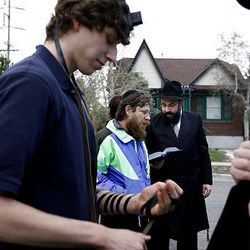 A prayer is read after burning the leavened food at Bais Menachem Synagogue Wednesday in Salt Lake City.